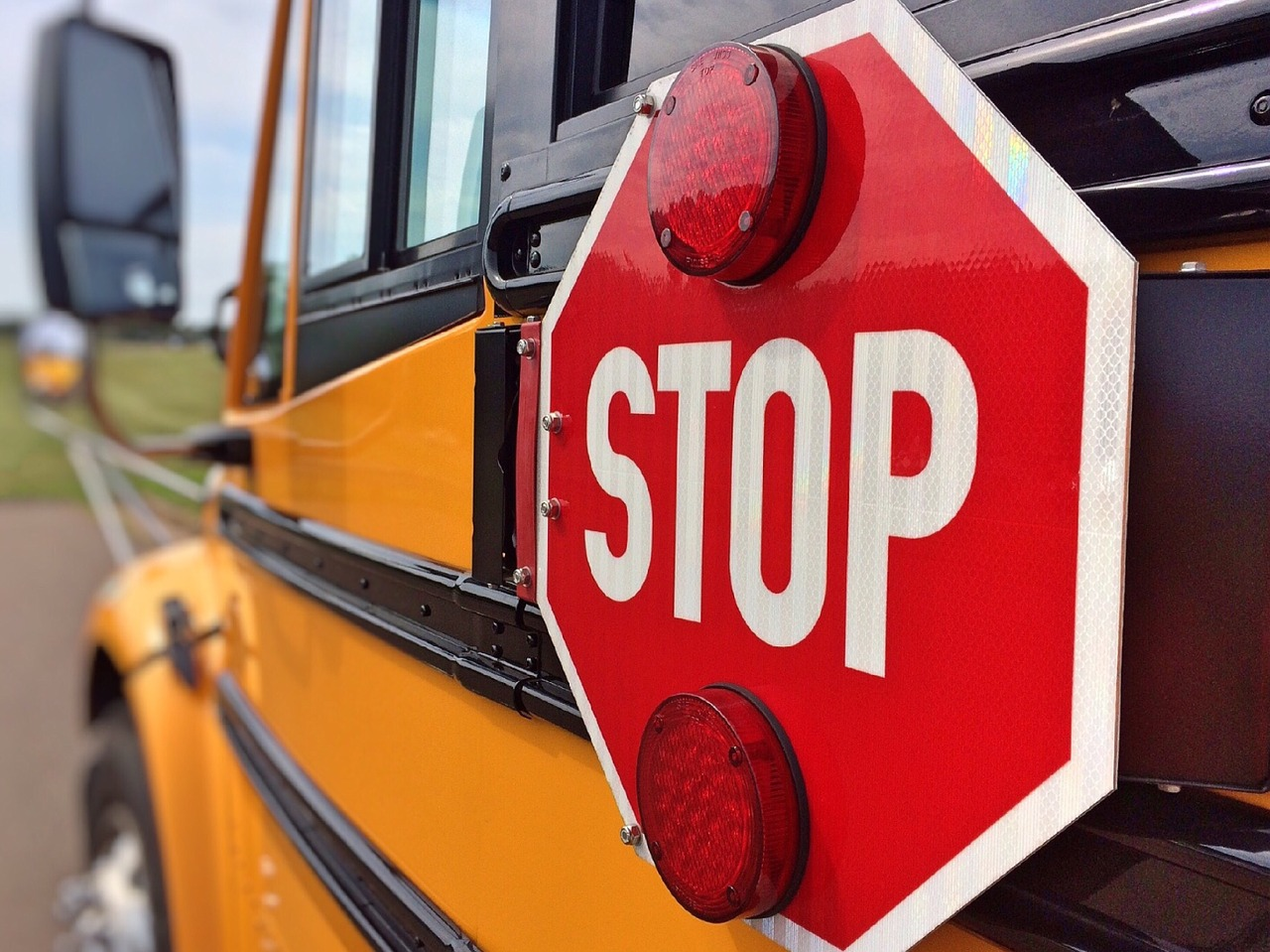 Stop arm on school bus