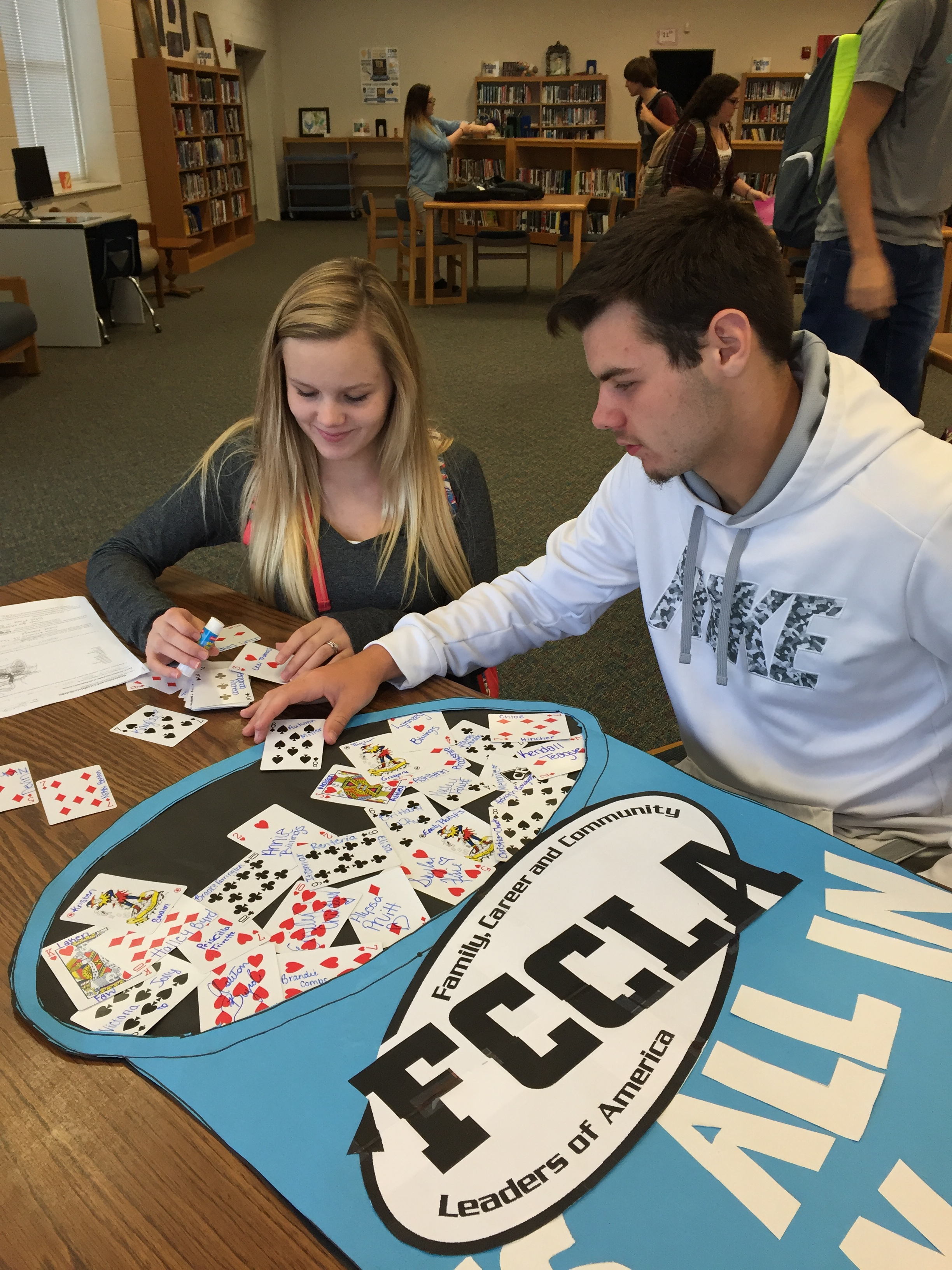 Christian and Hailey creating an FCCLA homecoming poster