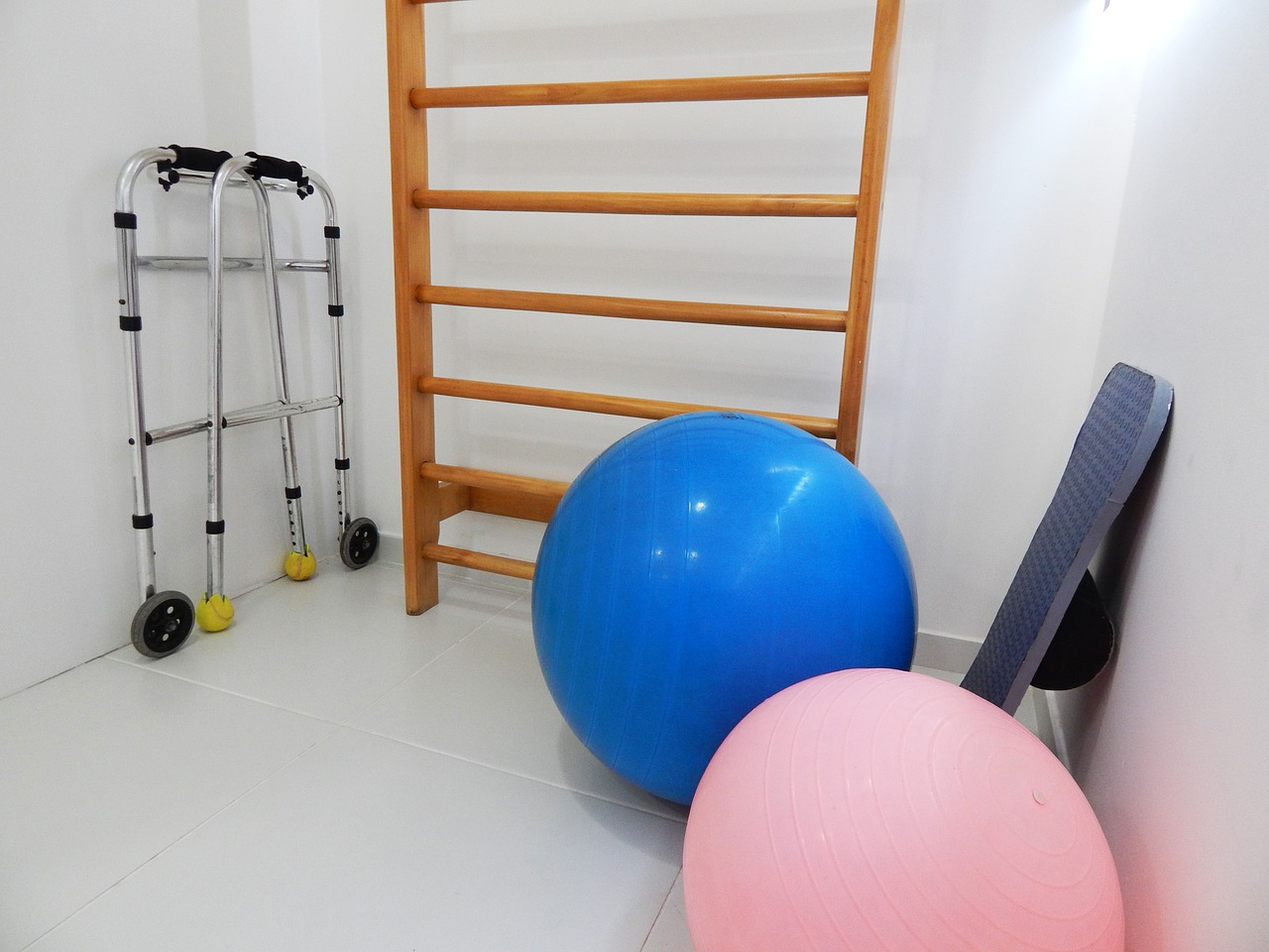 Walker, ladder, and exercise balls in a room